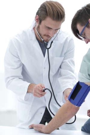 Physician measuring blood pressure to make a diagnosis Reklamní fotografie