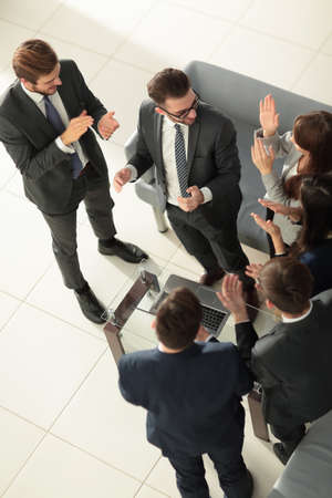 Happy successful business team giving a high fives gesture as th