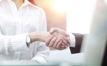 close-up of handshake businessman and business woman.