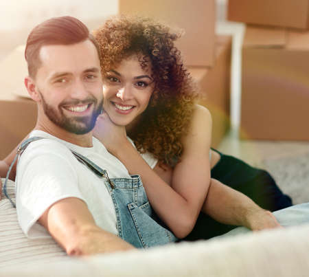 young couple in a new apartment. Concept of well-being