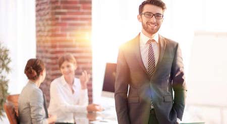 successful businessman on background of office. Standard-Bild