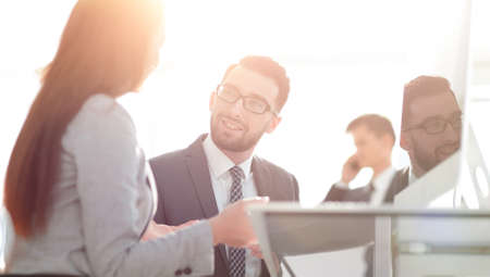 Confident man talking to his interviewer during a job interview Standard-Bild