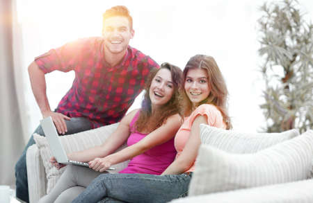 portrait of a group of young people sitting on the couch in the Standard-Bild