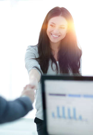 business woman welcomes colleague with handshake Standard-Bild