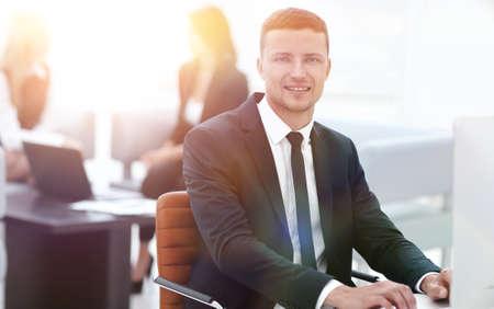 portrait of a successful businessman sitting behind a Desk