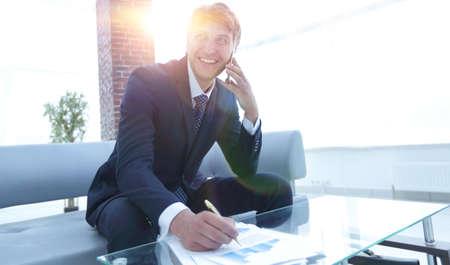 businessman talking on smartphone in office