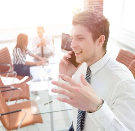 closeup.businessman talking on smartphone Standard-Bild