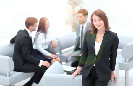 young business woman on blurred background office Standard-Bild