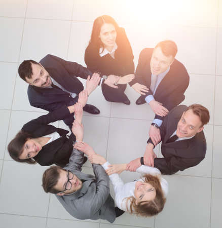 concept of partnership. business people standing in a circle. Standard-Bild