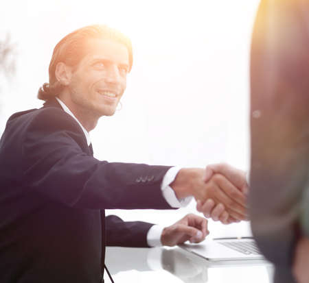 handshake colleagues in the office