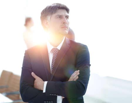 confident businessman stands and looks away. Standard-Bild