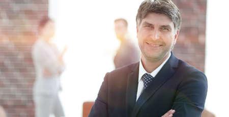Portrait of confident businessman on office background