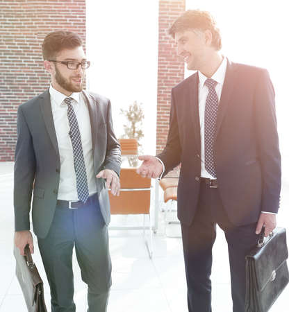 Two company employees discuss business issues