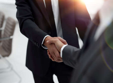 Cropped image of business people shaking hands Stock Photo