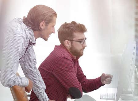 two Caucasian men working on a project Standard-Bild