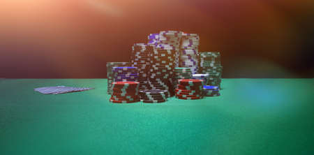 Stacked casino chips arranged on poker table Stock Photo