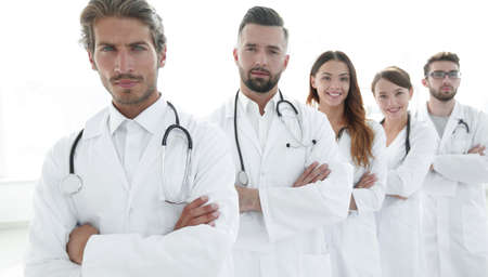 Portrait of medical team standing with arms crossed in hospital Stock Photo