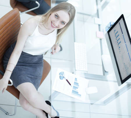 business people sitting at office desk in office. top view Stock Photo