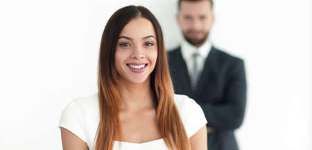 portrait of a business woman while the man is in the background Stock Photo