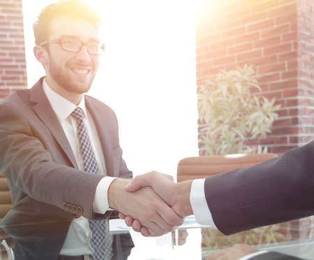 closeup. handshake between the financial Manager and the client