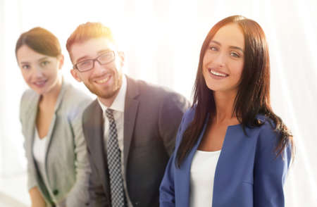 Young business woman smiling with her colleagues in the backgrou 스톡 콘텐츠