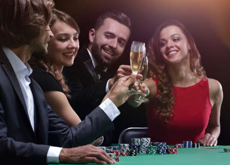 friends drinking and celebrating a gambling night Stock Photo