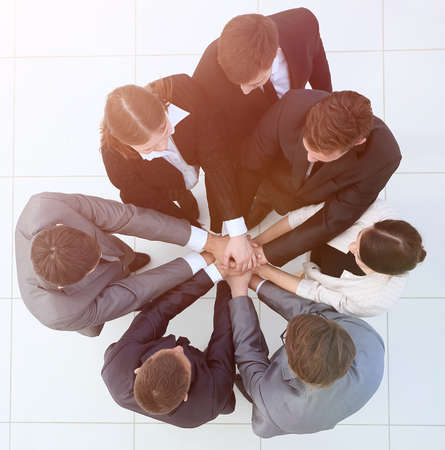 view from the top.business team holding hands. 스톡 콘텐츠