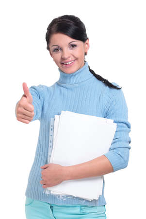 Young model showing thumbs up in studio over white background Stock Photo