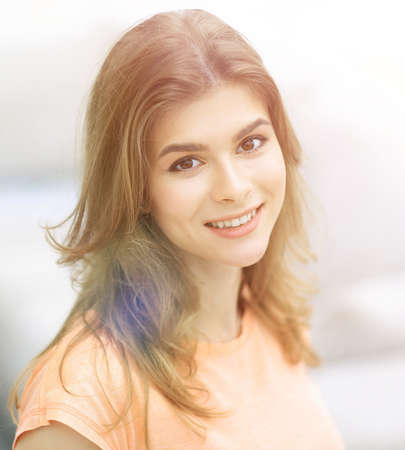 closeup portrait of a young woman on blurred background. Stock Photo
