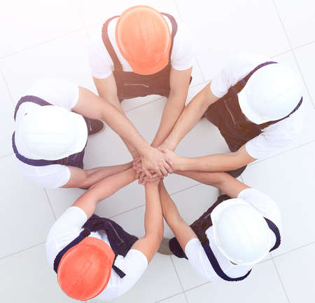 group of construction workers with hands clasped together Foto de archivo - 96170079