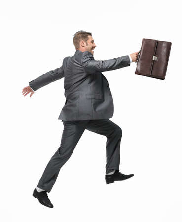 side view.cheerful businessman with briefcase stepping forward