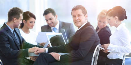 businessman and his business team with financial documents sitti
