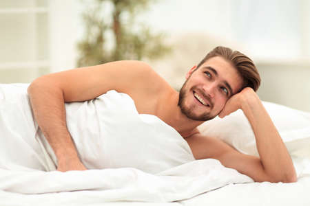 closeup.a man dreams of lying on the bed Stock Photo