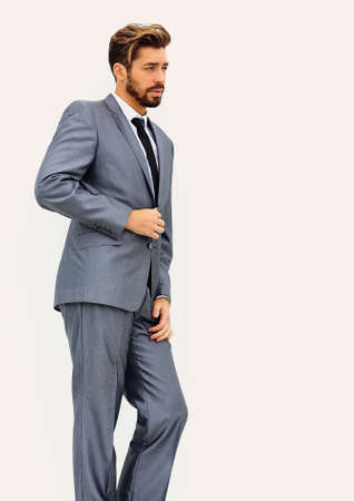 side view of an arrogant stylish man in suit Stock Photo