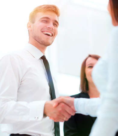 funny smiling businessman shaking hands with his partner. Stock Photo