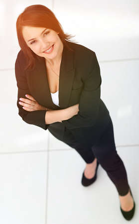 photo in full growth, successful business woman looking at camer Фото со стока