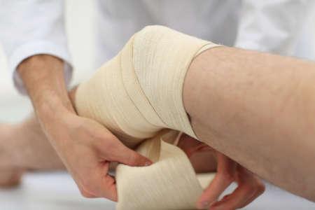 closeup. doctor bandaging a patients leg Stock Photo
