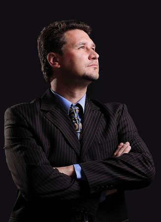 successful businessman on a dark background.