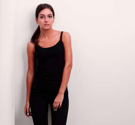 pensive young woman walking forward.