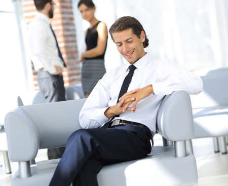 smiling businessman sitting in office chair Stock Photo