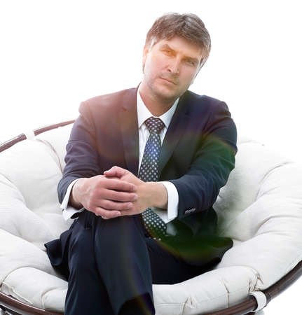 Successful businessman sits in a soft comfortable chair. Stock Photo