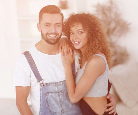 Happy young people standing in a new house Stock Photo