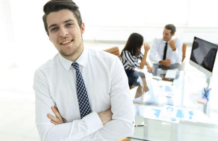 successful businessman on background of office. Stock Photo