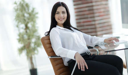 successful young business woman sitting at workplace Stock Photo