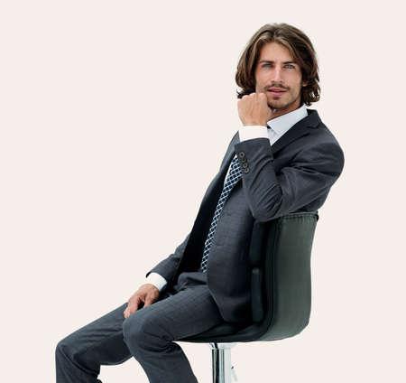 椅子に座ったエレガントなスーツを着た成功したビジネスマンのイメージ 写真素材 - 96982978
