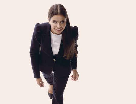 business woman walking in full length on white background Stock fotó