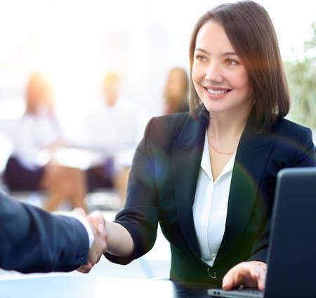 close-up of a handshake of a Manager and customer in the workplace