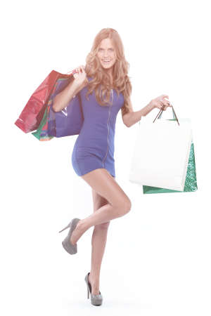 Portrait of young happy smiling woman with shopping bags, isolated