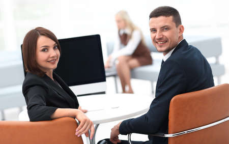 members of the business team sitting at Desk and looking at camera Stock Photo