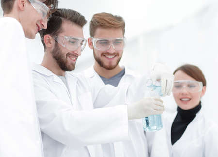 group of scientists working with chemicals